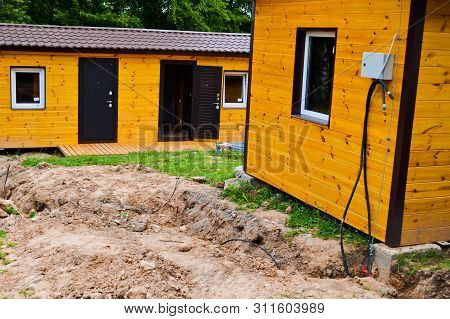 Construction Of Small Yellow Wooden Frame Prefabricated Pre-fabricated Eco-house Of Suburban Modular