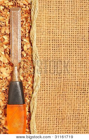 Old Steel Chisel On Sawdust Flakes Piled On Logs Of Sack