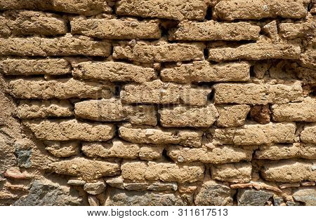 Background Of Old Wall Made Of Adobe Or Mudbrick Masonry