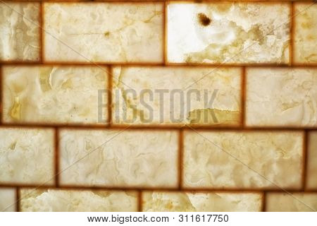 Onyx Brick Wall Background. Texture Of Honey Color Onyx Material