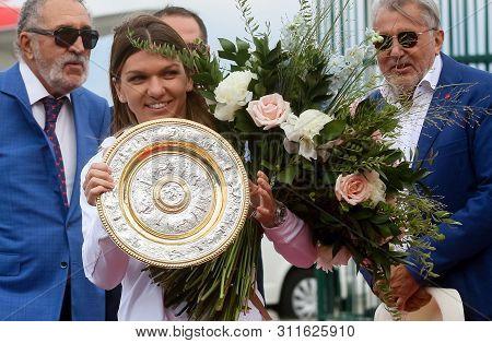 Bucharest, Romania - July 15, 2019: Wimbledon Women`s Singles Tennis Champion Simona Halep Poses Wit