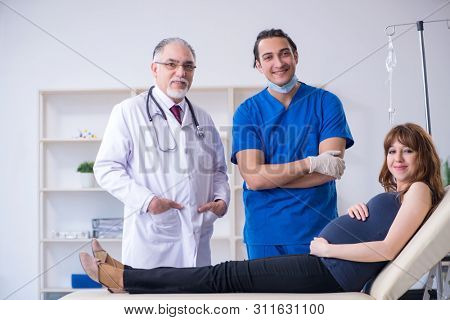 Two doctors examining young woman