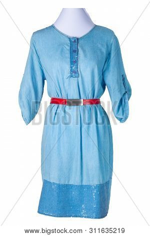 Woman Spring Summer Dress. Women's Blue Jeans Denim Dress With A Red Belt On A Mannequin Isolated On