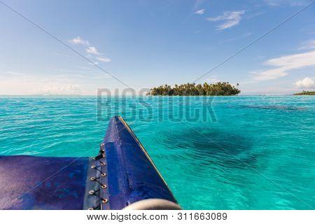 Boat excursion on catamaran going to private island in Bora Bora, Tahiti, French Polynesia.