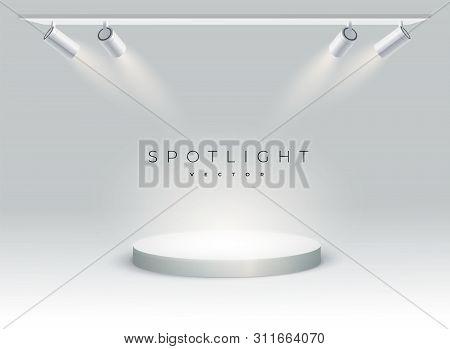 Five Modern Spotlights Shine On The Podium, Spot, Stage. Empty. Spotlight Shines At An Angle On Spot