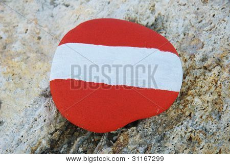 austrian flag colours on a stone