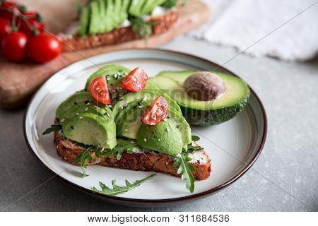 Healthy Breakfast With Avocado And Delicious Wholewheat Toast. Sliced Avocado On Toast Bread With Sp