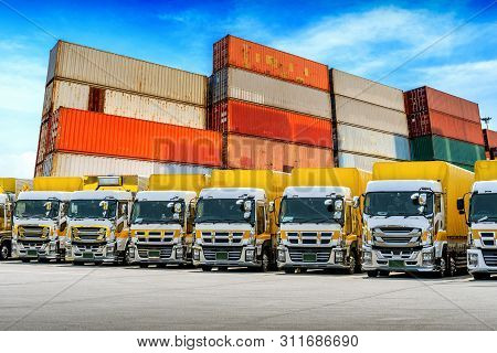 Row Of Cargo Vehicles And Containers. Freight Transportation. Cargo Truck Park.