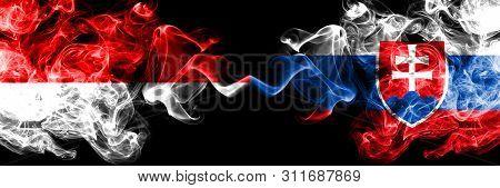 Indonesia Vs Slovakia, Slovakian Smoky Mystic Flags Placed Side By Side. Thick Colored Silky Smoke F