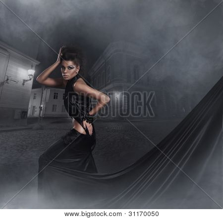 Fashion shoot of young sexy woman in black long dress