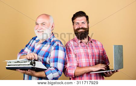 Old Generation. Bearded Men. Vintage Typewriter. Father And Son. Family Generation. Retro Typewriter