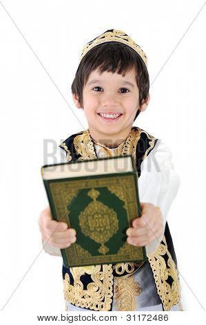Happy muslim kid holding holy Quran poster