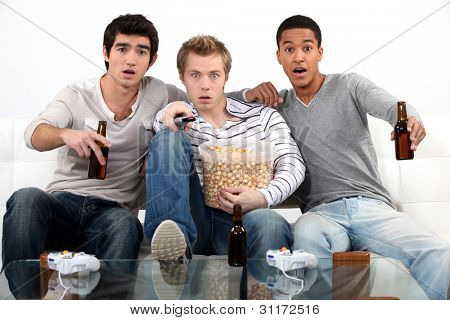 Young men watching a football game poster