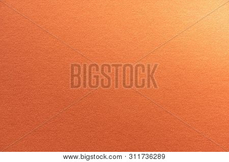 Abstract Orange Glitter Paper Texture Background Or Backdrop. Empty Shimmer Paper Or Shiny Paperboar