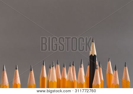 Vlogger And Influencer Social Media Marketing Concept. Black Pencil Protruding Out Of Crowd Of Simpl