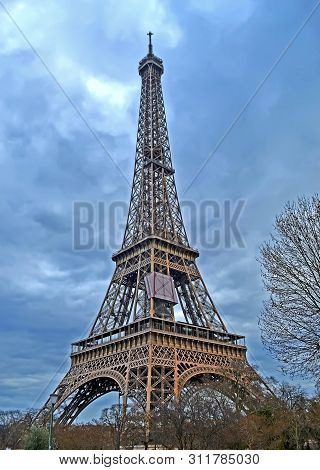 Eiffel Tower On Nasty Sky With Clouds In Paris, France, Europe Travel Diversity
