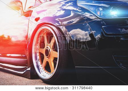 Close Up Of Headlight And Car Wheel With Custom Disk Of Tuned Low Rider Sport Car, Toned