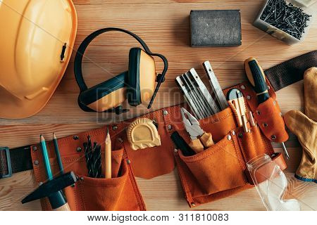 Professional Handyman Tool Belt On The Desk In Workshop