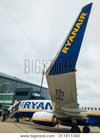 Gdansk, Poland - November 16, 2018: Ryanair lowcoster airlines aircraft parked at the airport runway. People are boarding the plane.
