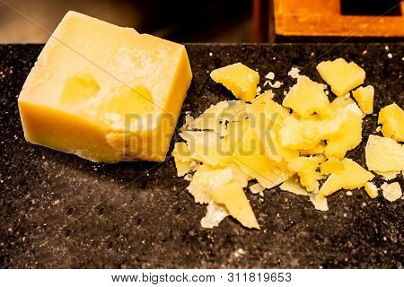 parmesan cheese on black stone plate in buffet line