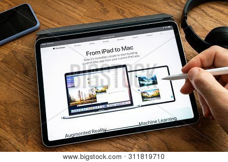 Paris, France - Jun 6, 2019: Man Reading On Apple Ipad Pro Tablet About Latest Announcement Of At Ap