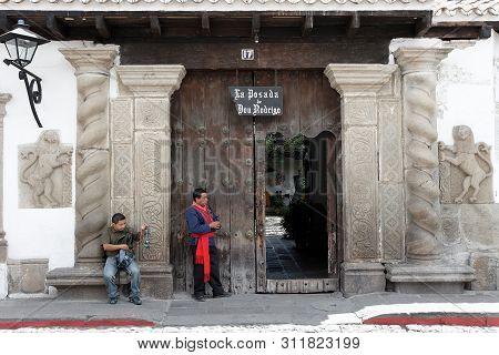 Antigua, Guatemala 03-01-2008 Two Local Men In Front Of A Posada Or Inn.