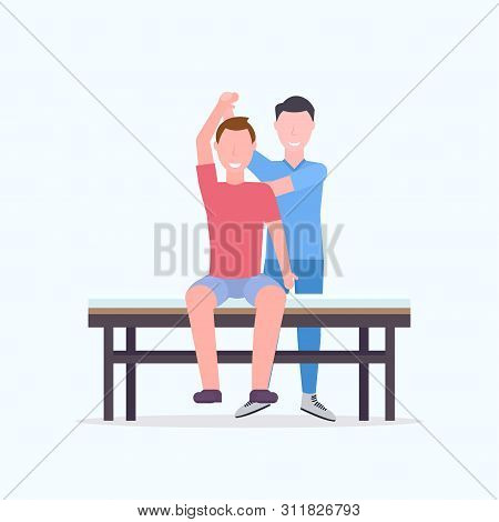 Young Man Sitting On Table Masseur Therapist Doing Healing Treatment Massaging Patient Body Manual T