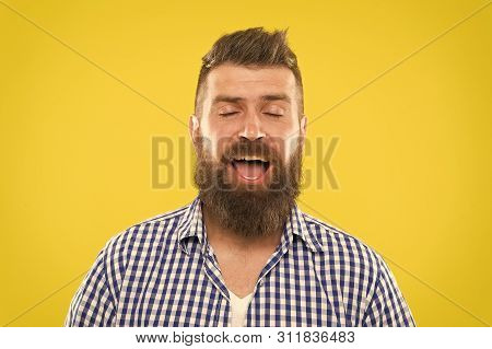 I Am Going To Sneeze. Man Bearded Hipster With Sneezing Face Closed Eyes Close Up Yellow Background.