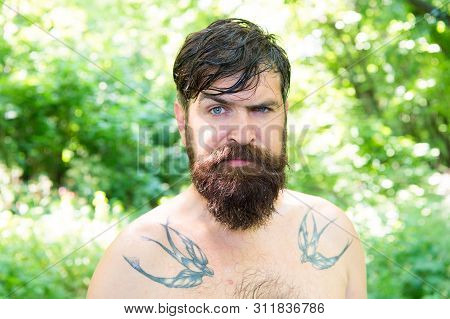 The Masculine Nature. Masculine Guy With Tattoo On Shoulders On Summer Landscape. Bearded Man Shirtl