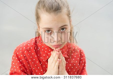 Ask permission. Banned behavior. Girl sad begging permission. Please concept. Girl helpless hold hands for pray. Let me please. Kid cute face close up. Mommy please. Forgive me. I am very sorry. poster
