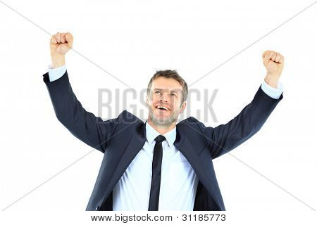 Excited handsome business man with arms raised in success - Isolated on white