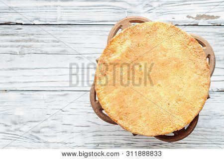 Naked Victoria Sponge Cake With Cake Stand Over A White Wooden Rustic Table Top. Image Shot For Abov