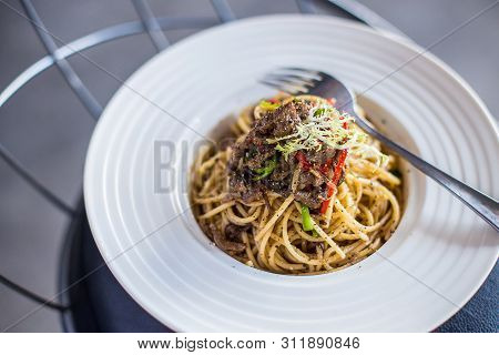 Black Pepper Beef Pasta In A White Ceramic Dish