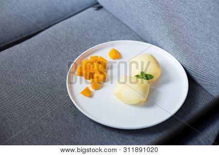 Mango Dessert Cakes In A White Ceramic Dish