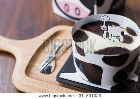 Minced Milk Cow Cake On A Wooden Dish