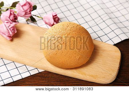 Sweet Curry Bread On A Wooden Dish