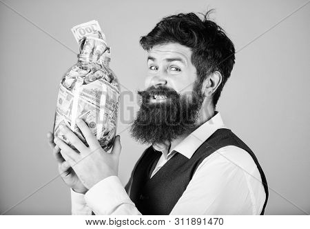 poster of Engaging in investment activity. Happy businessman making a good investment. Bearded man investor smiling with investment money in glass jar. His investment producing income