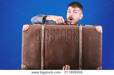 poster of surprised businessman in bow tie. stylish esthete with vintage bag. business trip with retro suitcase. heavy bag. mature traveller. bearded man in formal suit. Confident businessman. Pure confidence