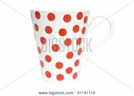 White coffee cup with red dots on white background. Clipping path included.