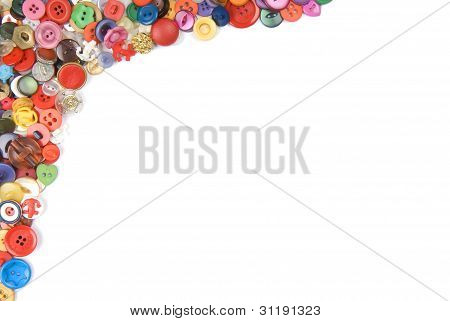 Collection of different buttons arranged around the border.