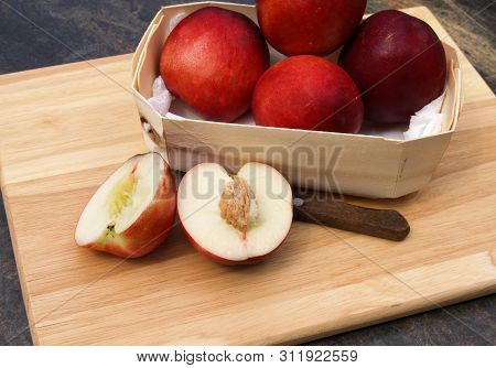 Fresh Nectarines Being Prepared On Wooden Chopping Board Fresh Whole Nectarines In Wooden Bowl, Halv