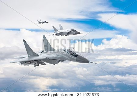 Three Combat Fighter Jet On A Military Mission With Weapons - Rockets, Bombs, Weapons On Wings Flies