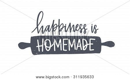 Happiness Is Homemade Phrase Handwritten With Cursive Calligraphic Font Or Script On Rolling Pin. El