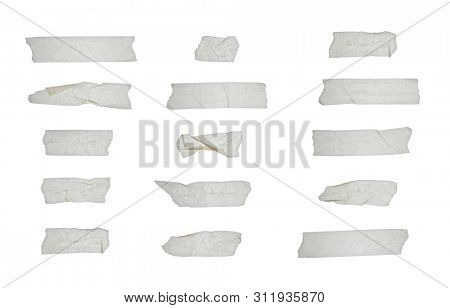 Set of various adhesive tape pieces isolated on white background. Strips of masking tape. Paper tape texture.