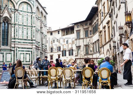 Florence, Italy - April, 2018:  Tourists At A Restaurant Next To The Beautiful Florence Cathedral Co