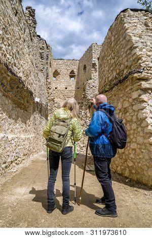 Visitors Looking At Walls Of Blatnica Castle, Slovakia