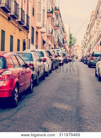 Madrid, Spain - April 6: Old Narrow Street Is Crowded With Parked Carsin Madrid, Spain. It Is Old Ce