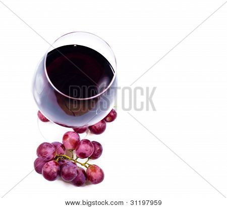 Wine Glass With Red Wine And Grapes
