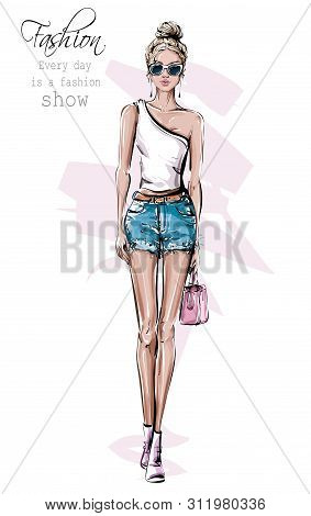 Hand Drawn Beautiful Young Woman In Sunglasses. Fashion Female Outfit. Stylish Girl In Jeans Shorts.
