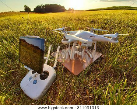 Pilsen / Czech Republic - June 16, 2019: Drone quadrocopter Dji Phantom 3 Professional with camera preparing to start. Take off for monitoring private property. UAV working in agriculture.